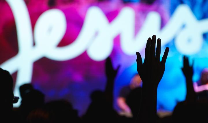 Lifted hands in worship of Jesus